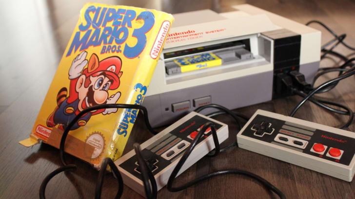 A Super Mario Bros. 3 game next to an NES console