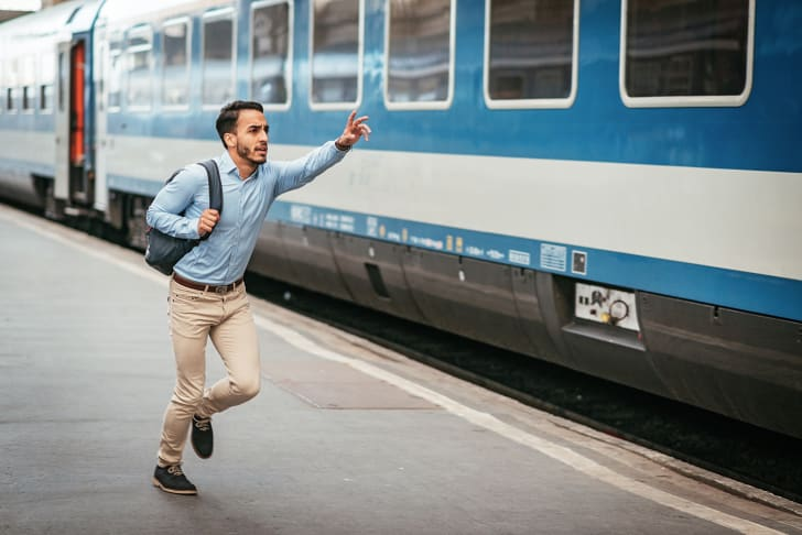 Young man runs to catch a missed train
