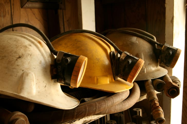 A picture of mining helmets on a shelf.