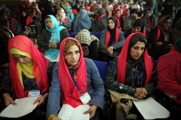 Afghan women attend a ceremony to mark International Women's Day, on March 8, 2010 in Herat, Afghanistan