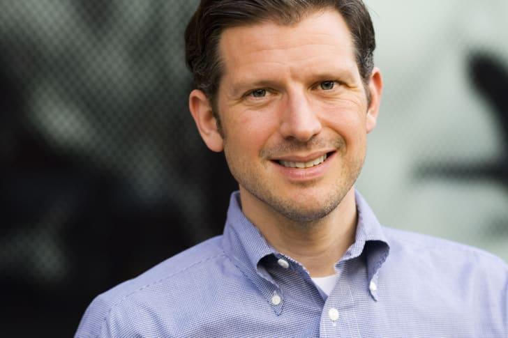 A man in a button-down shirt