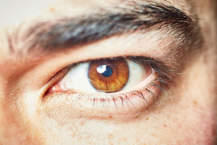 A close-up of a man's eye is pictured