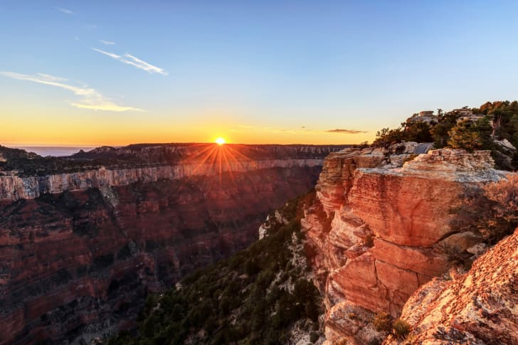 The sun sets over the Grand Canyon at Bright Angel Point.
