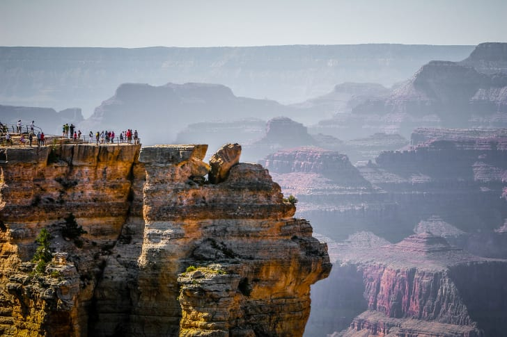 Tourists stand at Mather Point