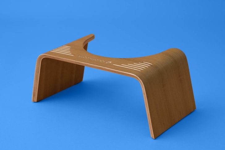 A teak-colored Squatty Potty Slim