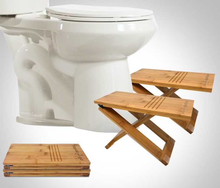Two foldable toilet stool pieces in front of a toilet