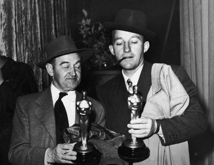 Barry Fitzgerald (1888 - 1966) (left) holds his Oscar for Best Supporting Actor while American actor Bing Crosby (1904 - 1977) holds his Oscar for Best Actor, both for their roles in 'Going My Way,' Academy Awards, Los Angeles, California, March 15, 1945.