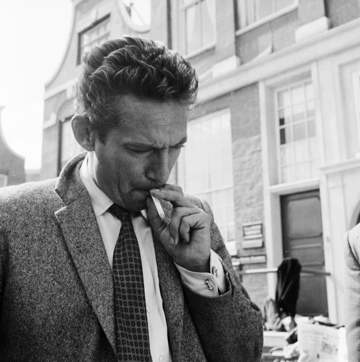 August 1958: British actor Peter Finch (1916 - 1977) at Pinewood Studios, for the filming of the Michael McCarthy picture 'Operation Amsterdam