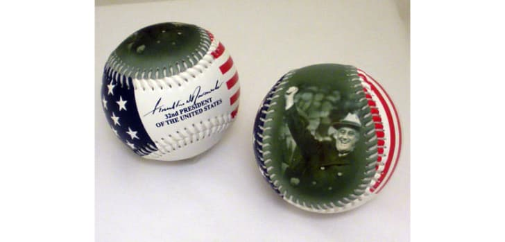 A baseball featuring an image of Franklin Roosevelt holding up a baseball