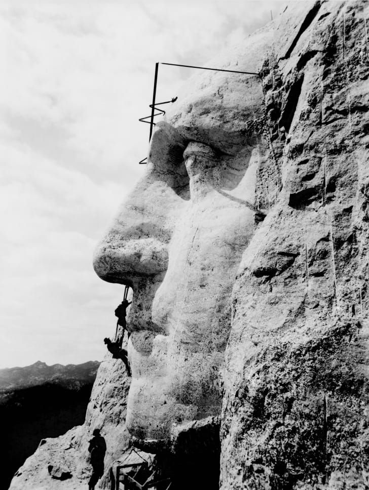 Workers construct George Washington's image on Mount Rushmore