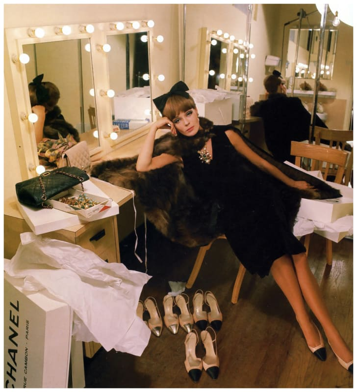 A Chanel little black dress and accessories photographed for French Vogue in 1964.