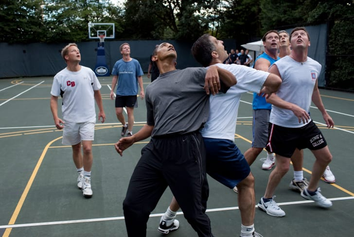 Obama playing basketball with his staff.