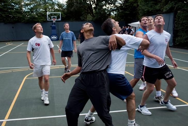 Obama playing basketball with his staff.
