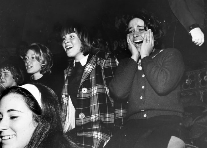 10th February 1964: A group of Beatles fans watching their heroes perform on the American television programme 'The Ed Sullivan Show'