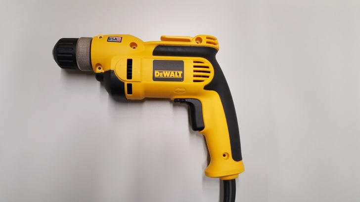 A yellow and black DeWALT drill