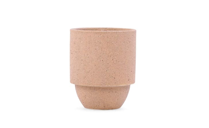 A pink cement candle jar