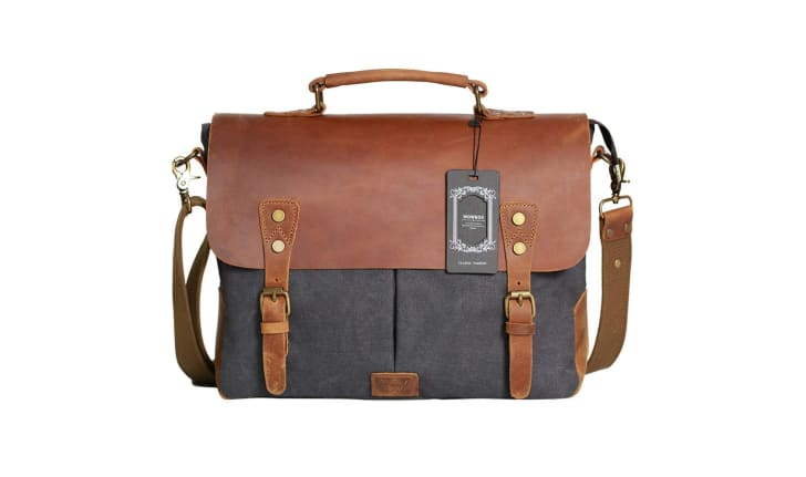 A leather and gray canvas messenger bag