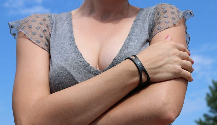 A woman wearing a Perk bracelet