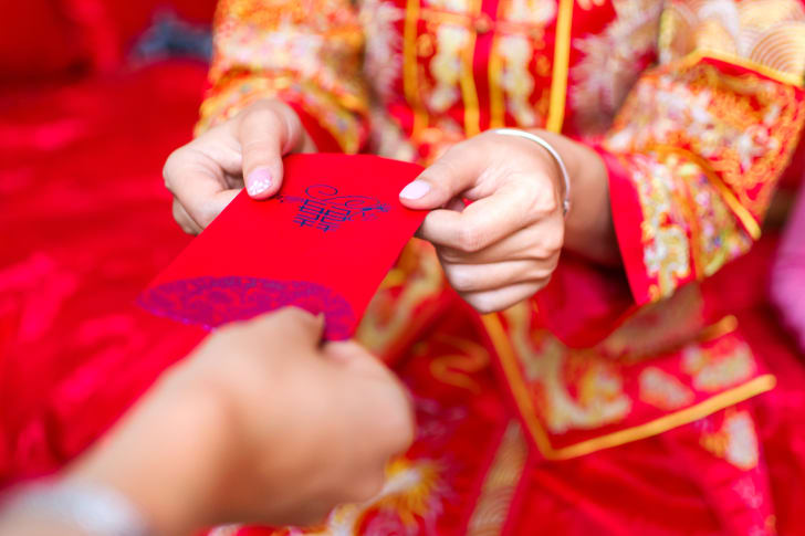 a person accepting a red envelope