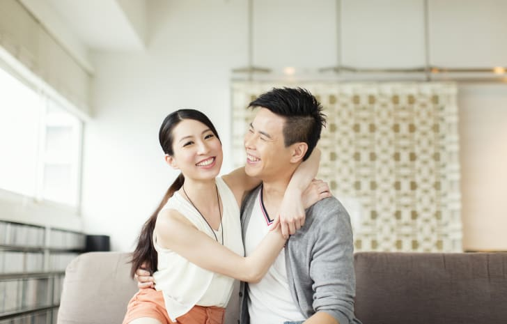 Young Asian couple smiling