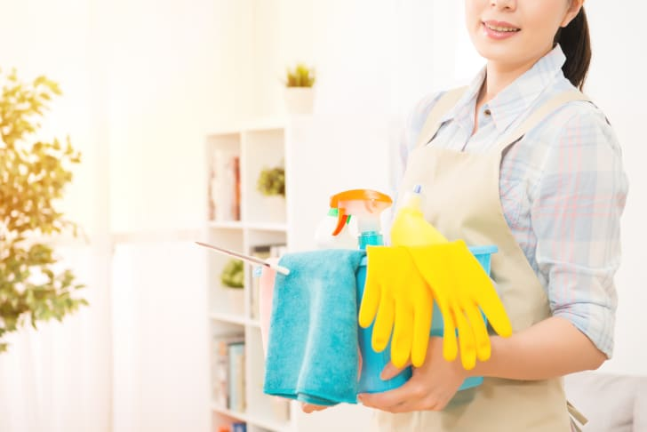 woman ready to clean a home