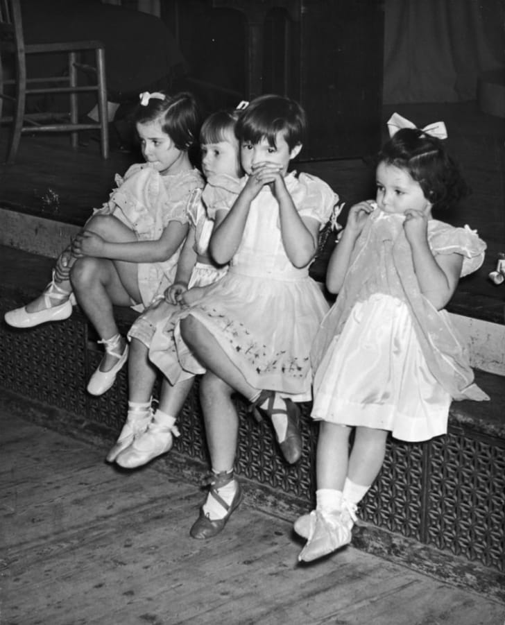 School children sit next to one another circa the 1950s