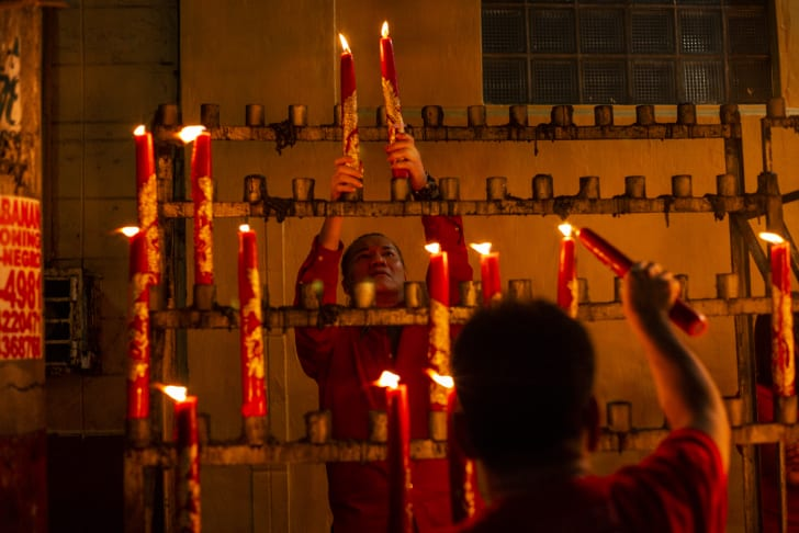 Filipinos flock to a local temple as they celebrate the lunar new year in Manila, Philippines.