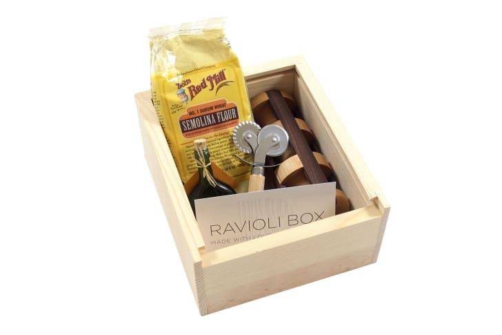 A ravioli-making kit in a wooden box
