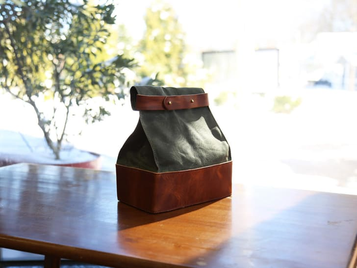 Leather lunch bag on table
