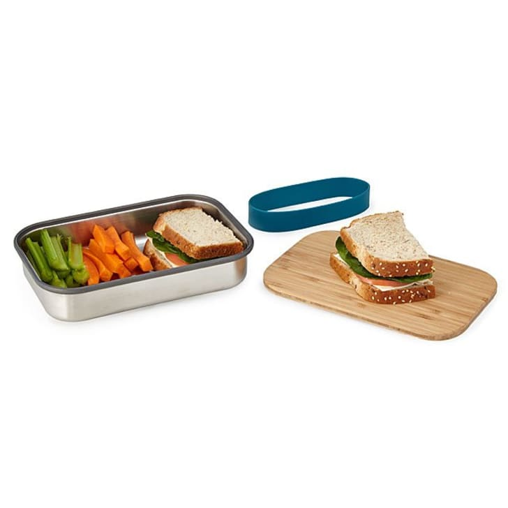 Lunch container with sandwich and cutting board lid
