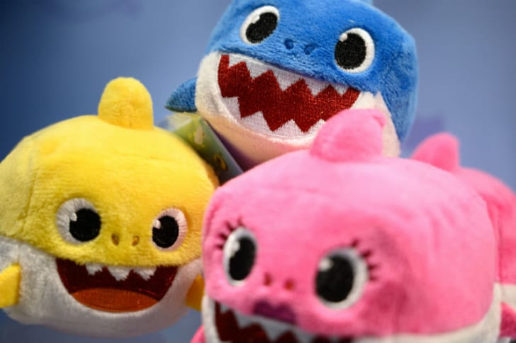 An assortment of 'Baby Shark' stuffed toys is displayed at Toy Fair