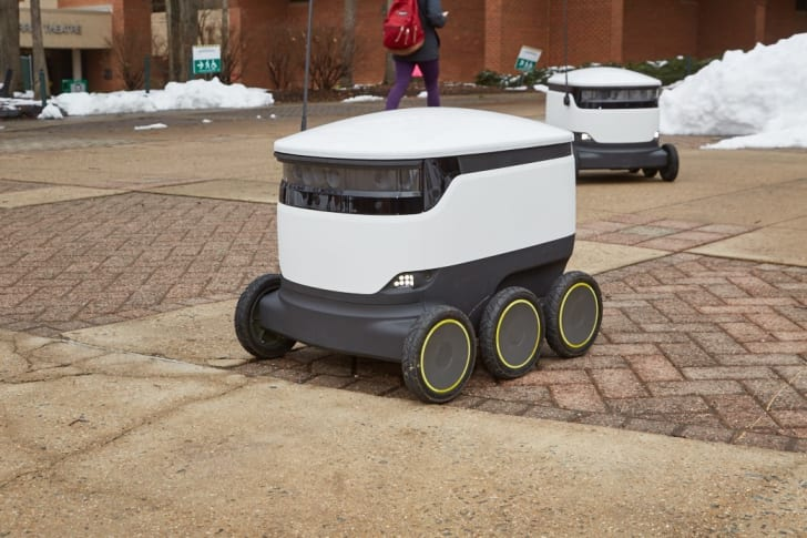 Food delivery robot outdoors.