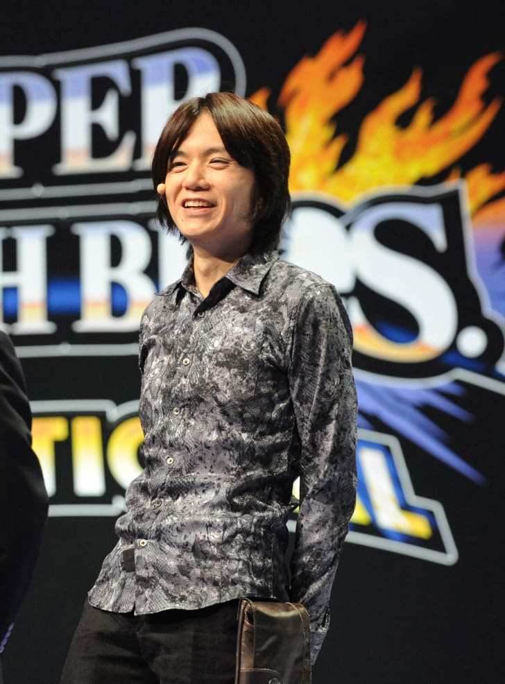 Masahiro Sakurai, creator and director of Nintendo's Super Smash Bros. series, welcomes the crowd at an event in 2014.