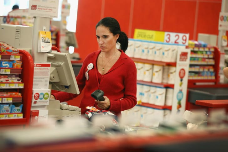 A Target employee works at a register
