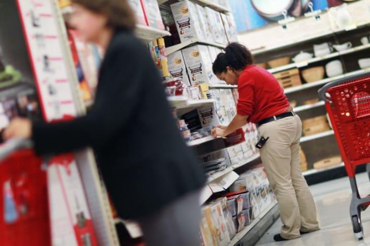 A Target employee is seen standing near a customer