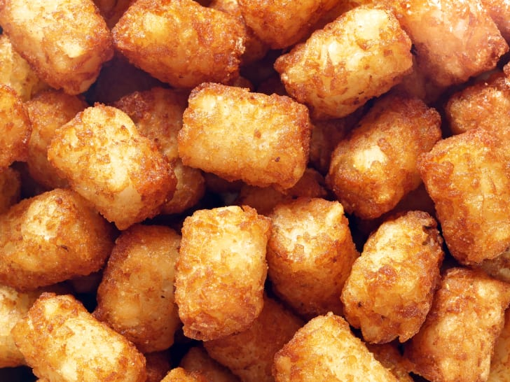 A pile of golden brown tater tots