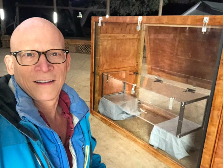 """Steve Wolf with the coffin used in the Buried Alive trick on """"Houdini's Last Secrets"""""""