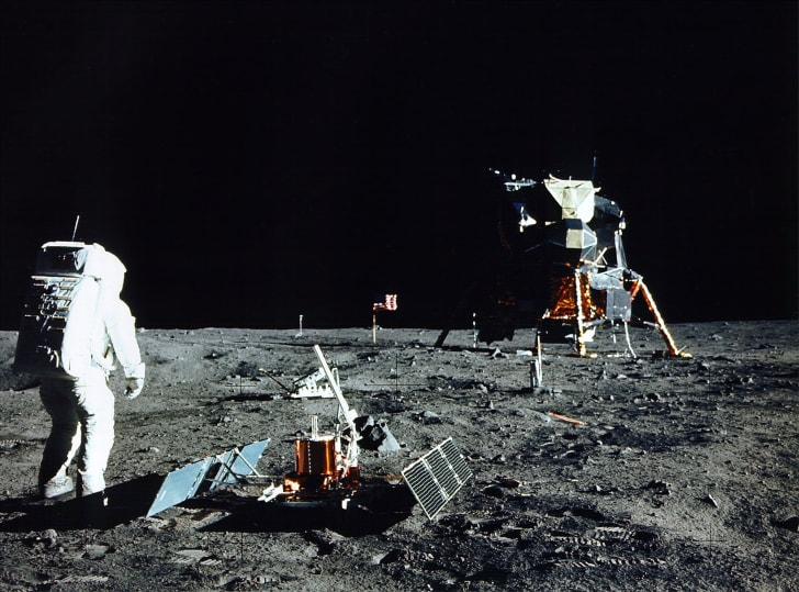 An image of Buzz Aldrin performing an experiment on the Moon.