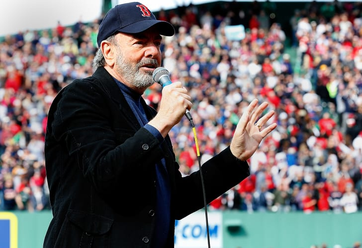 Neil Diamond sings 'Sweet Caroline' during a game between the Kansas City Royals and Boston Red Sox in the 8th inning at Fenway Park on April 20, 2013 in Boston, Massachusetts