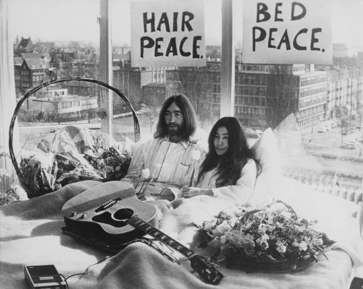 John Lennon and Yoko Ono in their bed in the Presidential Suite of the Hilton Hotel, Amsterdam, 25th March 1969. The couple are staging a 'bed-in for peace' and intend to stay in bed for seven days 'as a protest aga