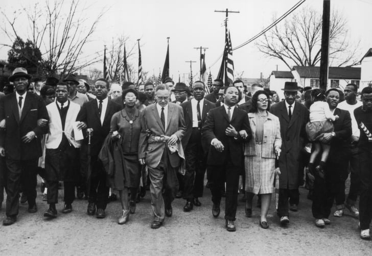 Martin Luther King Jr. and his wife, Coretta Scott King, lead a black voting rights march from Selma, Alabama, to the state capital in Montgomery in March 1965.