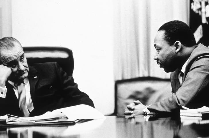 President Lyndon B Johnson discusses the Voting Rights Act with civil rights campaigner Martin Luther King Jr. in 1965.
