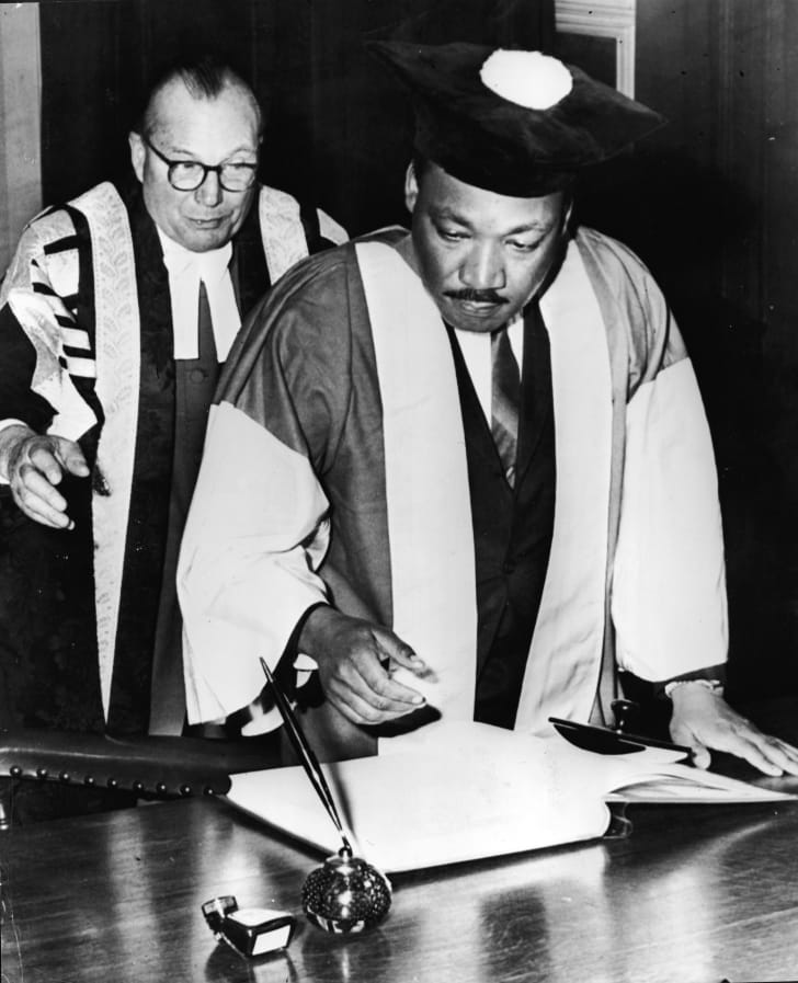 Dr. King receives an honorary Doctor of Civil Law degree at Newcastle University in England, November 14, 1967. He had earned a doctorate in theology in 1955.