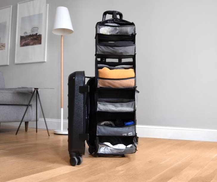 The Carry-On Closet open to show the expanded shelving unit