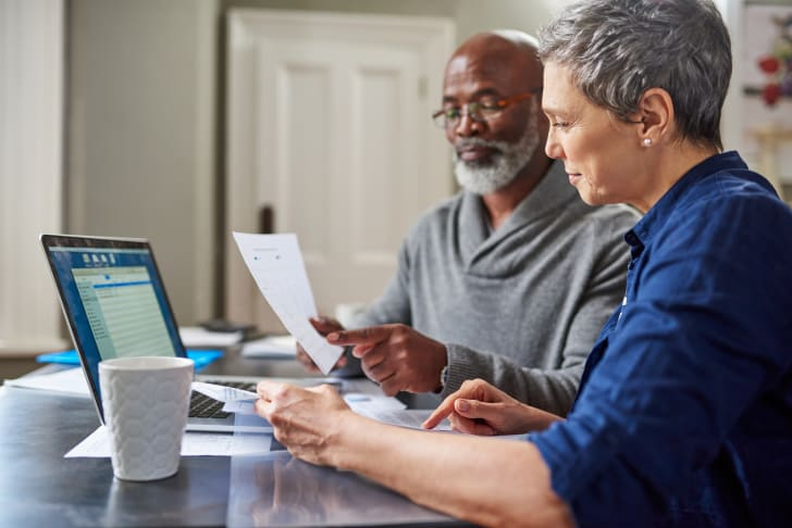 A couple works on their annual taxes