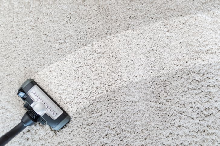 Photo of a carpet being steam cleaned