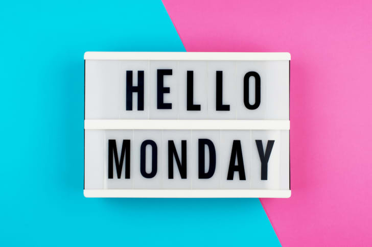 'Hello Monday' text on a display lightbox on blue and pink bright background