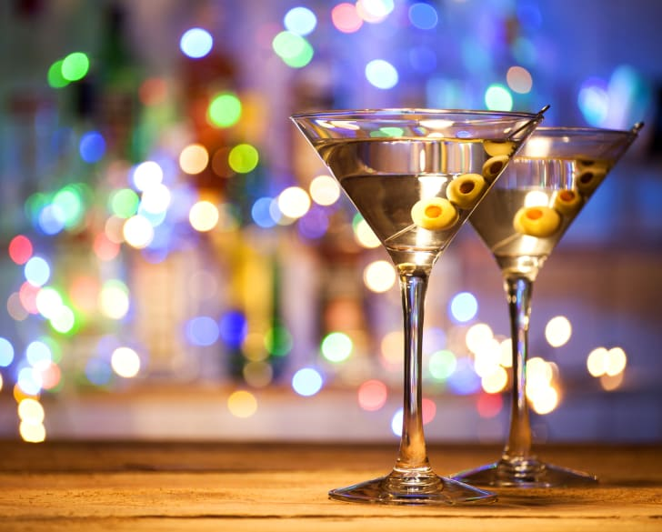 Two martini glasses with olives.