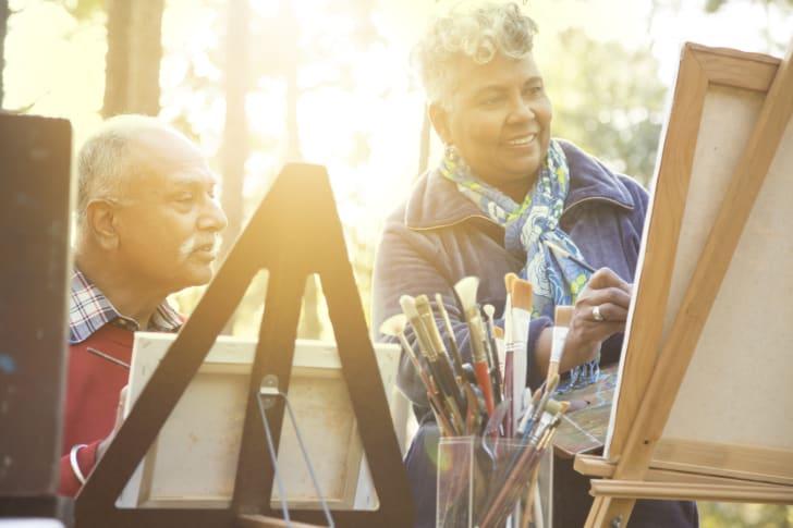 Couple paints outdoors