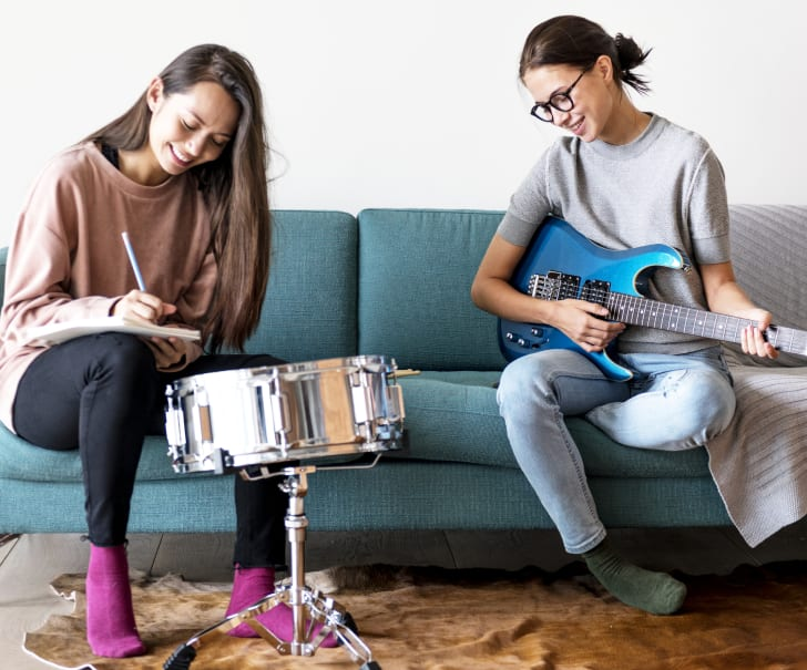 Women playing music together at home